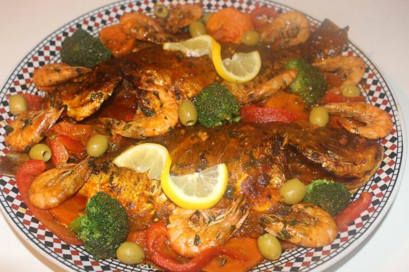 Dorade met garnalen en groente uit de oven